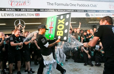 Mercedes Formula One team members spray champagne after winning the 2014 constructors World Championship at the first Russian Grand Prix in Sochi