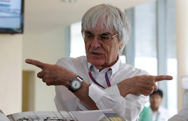 Formula One supremo Bernie Ecclestone gestures during the presentation of a commemorative book presented to him on the occasion of his birthday at the Indian F1 Grand Prix at the Buddh International Circuit in Greater Noida