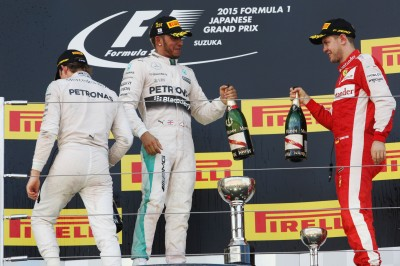 Formula One World Championship 2015, Round 14, Japanese Grand Prix, Suzuka, Japan, Sunday 27 September 2015 - The podium (L to R): Nico Rosberg (GER) Mercedes AMG F1, second; Lewis Hamilton (GBR) Mercedes AMG F1, race winner; Sebastian Vettel (GER) Ferrari, third.